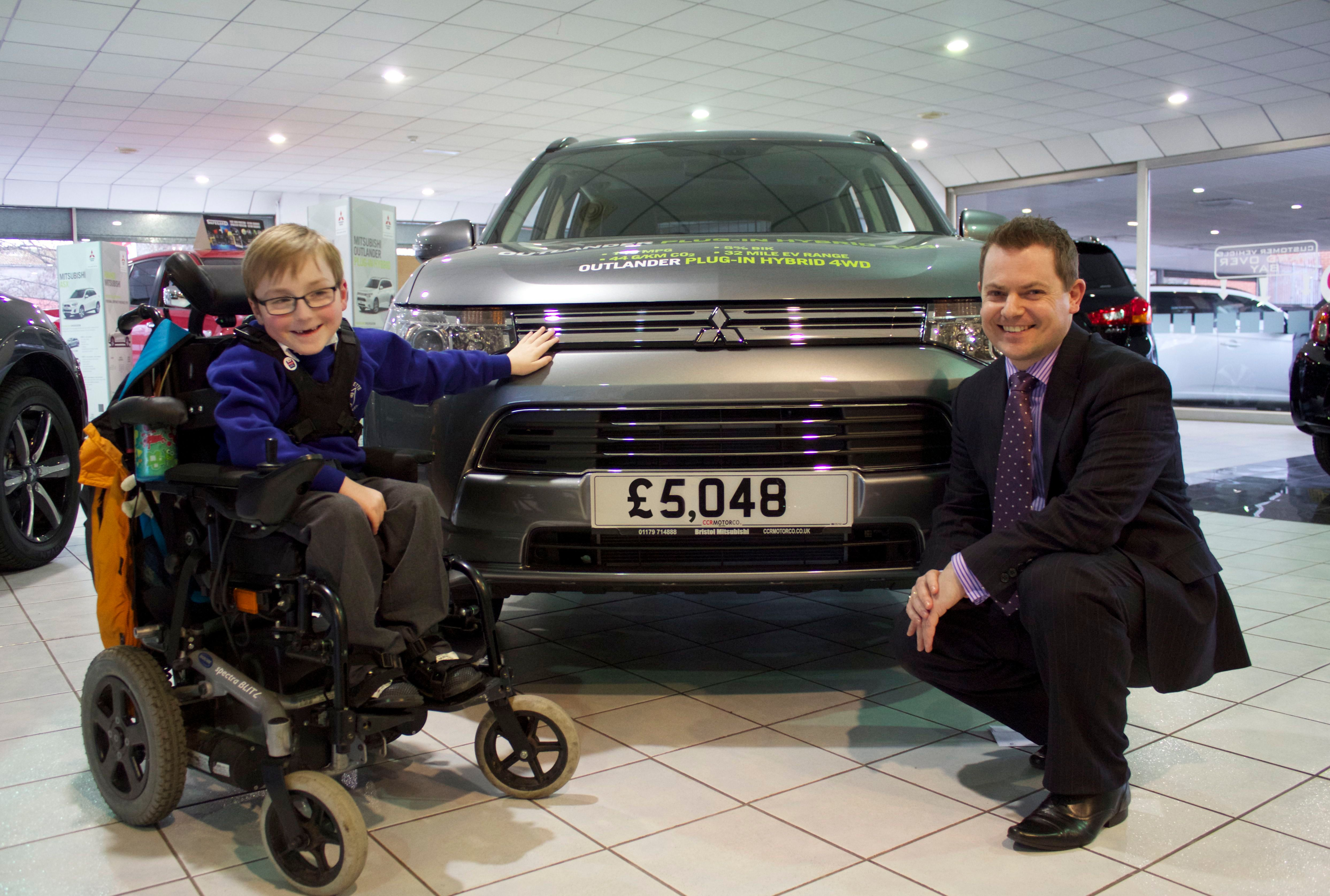 MITSUBISHI DEALERSHIP RAISES THOUSANDS  TO HELP BOY WALK